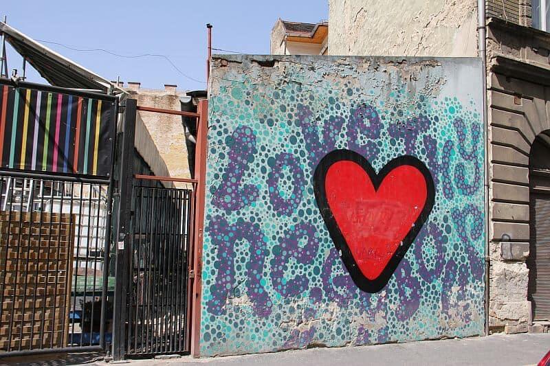Love thy Neighbours street art Luke Embden in Budapest